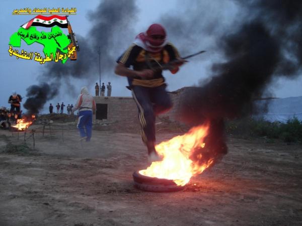 جيش النقشبندية قصف مقر للعدو الامريكي بصاروخ النذير بتاريخ 12-2-2013 211